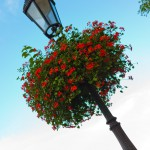 Transform a lamp post with flowers, glitter, ribbon!